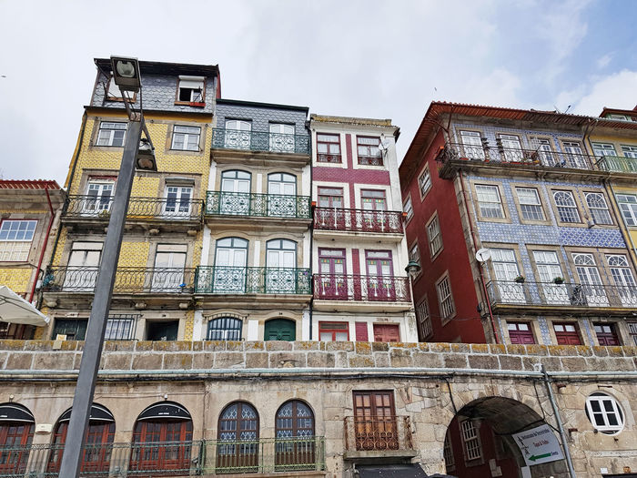 Building Exterior Architecture Built Structure Window Low Angle View Sky Building Residential District No People Day City Nature Outdoors In A Row Cloud - Sky Arch Balcony Old Side By Side History Apartment Location Porto Porto Portugal 🇵🇹 Vacations Vacation Vacation Time Vacation Destination Portugal Portugal Is Beautiful Europe Europe Trip European  European Union European Architecture