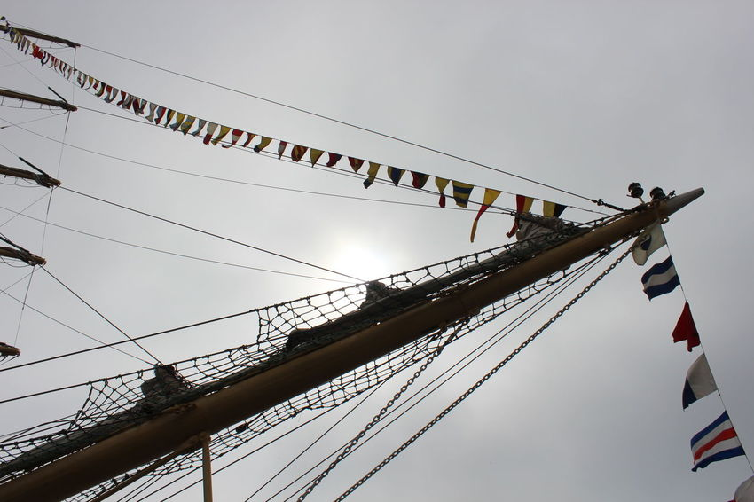 Against The Sun Bow (ship) Cloudy Day Flags Low Angle View No People Part Of Sailing Ship