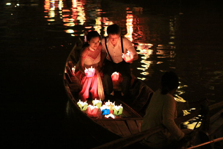 Couple Hoi An Adult Birthday Birthday Cake Burning Candle Celebration Couple - Relationship Couples Diya - Oil Lamp Flame Flower Friendship Illuminated Men Night Oil Lamp Outdoors People Real People Sitting Togetherness Water Water Festival EyeEmNewHere EyeEm Ready