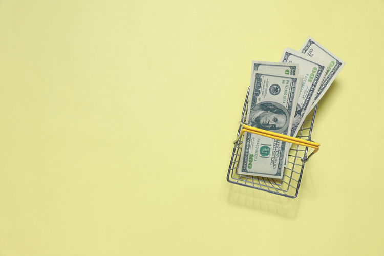 Finance Paper Currency Currency Business Copy Space Indoors  Studio Shot Wealth No People Savings Cut Out Number Colored Background High Angle View Yellow Communication Paper Still Life Close-up Economy