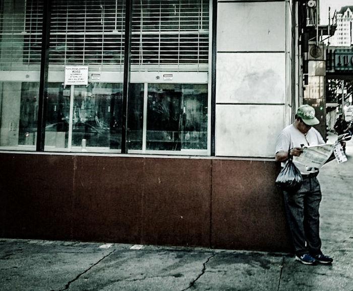 Morning news.. Newspaper News Retro Oldfashioned Man People Reading Downtown Corner