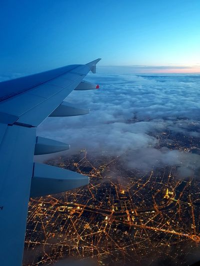 Coucher de soleil sur Paris Paris Paris, France  Cloud - Sky Plane Flight Blue Sky Sea Technology Air Vehicle Water Sky