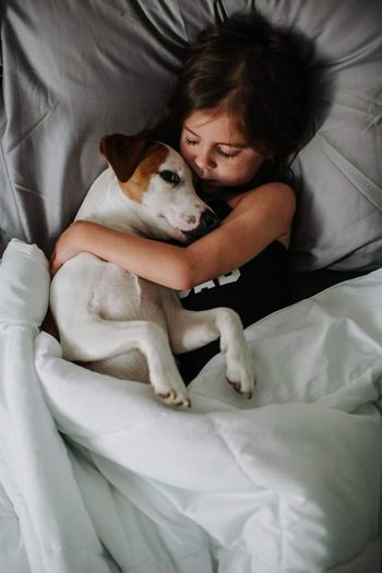 Sweet snuggles Pets Dog One Animal Domestic Animals Bed Mammal High Angle View Animal Themes Real People One Person Indoors  Bedroom Sheet Friendship Day Young Adult People Adult The Week On EyeEm