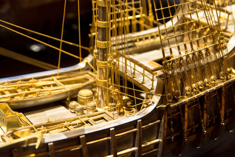 Close-Up Of Gold Caravel Ship Model At Museum