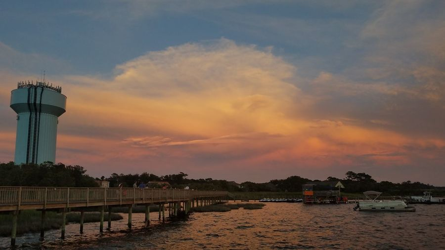 Sunset Cloud - Sky Dramatic Sky Water Silhouette Sky Reflection Beach Vacations Sea Landscape Travel Destinations Tranquility Nautical Vessel No People Blue Outdoors Tree Scenics Summer
