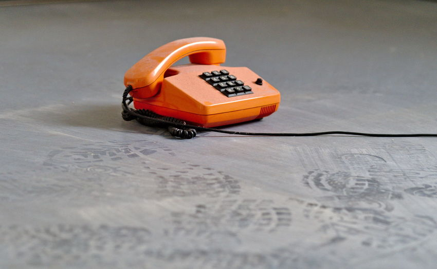 Technology Connection Single Object Retro Styled Telephone Communication Still Life Selective Focus No People Table Toy Car Landline Phone Indoors  Wireless Technology Close-up Nostalgia Orange Color Day Form Of Communication Keypad