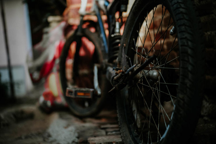 Vinatage abandoned bicycle Transportation Mode Of Transportation Wheel Land Vehicle Bicycle Tire Stationary Spoke No People Close-up Outdoors Focus On Foreground Day Selective Focus Pedal Travel Vehicle Part Motorcycle Street Nature