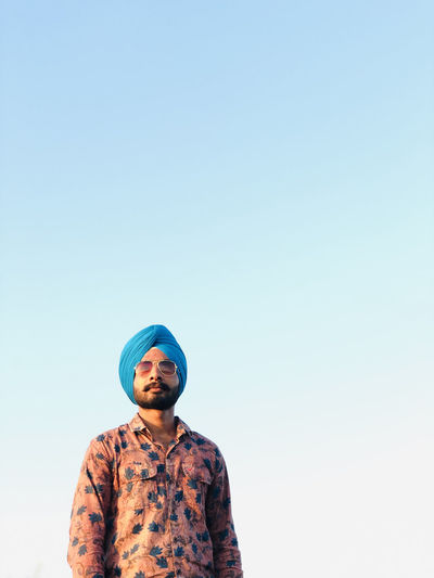 Portrait of man wearing turban against clear sky