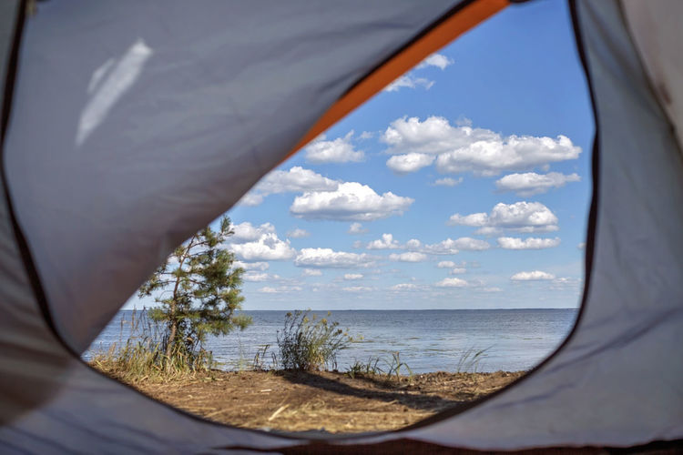 Scenic view of sea seen through tent
