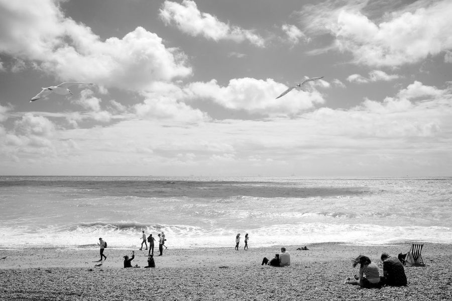 Brighton Beach Life Black & White Seagulls Beach Blackandwhite Cloud - Sky Day Horizon Over Water Leisure Activity Lifestyles Outdoors People Real People Scenics Sea Shore Sky Vacations Water Wave Weekend Activities