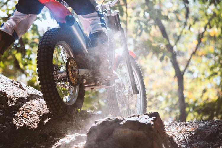 Man riding motorcycle on rock