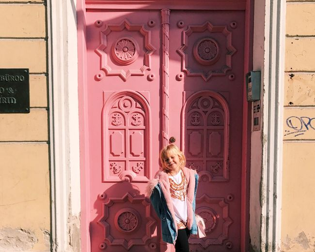 Entrance Real People Architecture Door Building Exterior One Person Built Structure Day Outdoors Women Standing Childhood Wall - Building Feature Lifestyles Rear View Building Child Pink Color Hairstyle Full Length