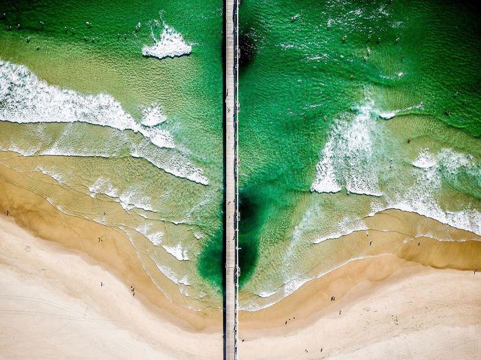 Aerial view of footbridge over sea