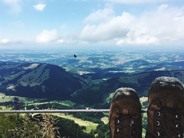 Cloud - Sky Mountain Sky Day Human Leg Shoe Scenics Nature Tranquil Scene Beauty In Nature Tranquility One Person Leisure Activity Mountain Range Landscape Outdoors Real People Lifestyles Human Body Part Low Section