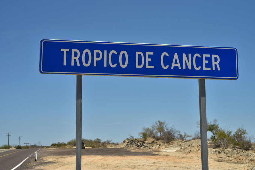 Tropico de Cancer is a Spanish language road sign in Baja California Sur Mexico that marks the line that we call, in English, the Tropic of Cancer--a global map line north of the Equator Baja California Sur Map Mexico Sign Spanish Language Equator Road Side Road Sign Road Trip Tropic Tropic Of Cancer Tropical