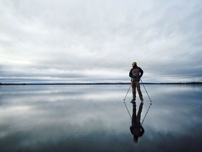 Water Cloud - Sky Sky One Person Reflection Sea Nature Beauty In Nature Day Scenics - Nature Full Length Standing Tranquility Tranquil Scene Adult Men Real People Outdoors Horizon Over Water
