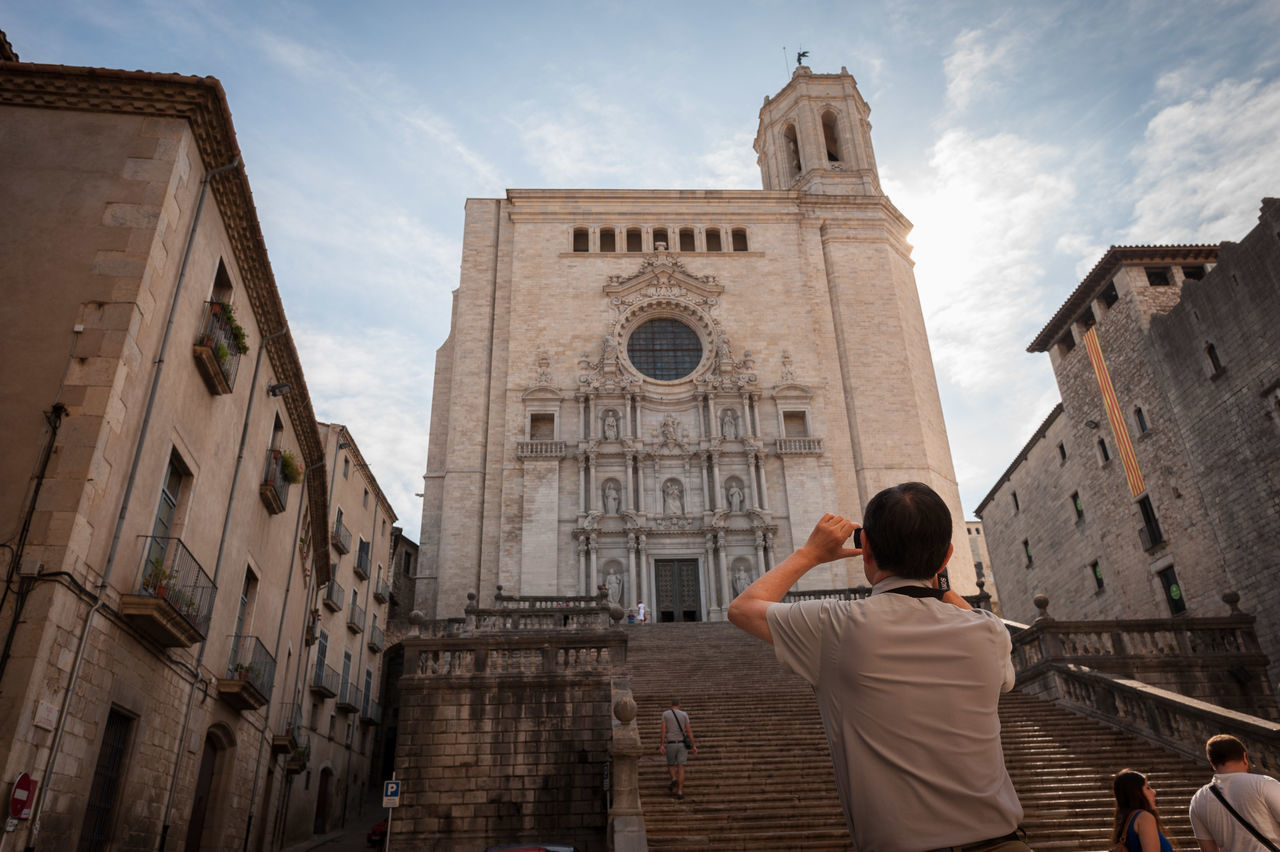 Man Taking Picture of A Building