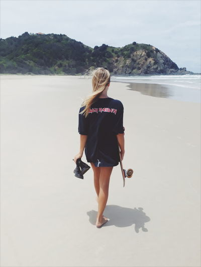 Skateboarding Beach Casual Clothing Day Full Length Leisure Activity Lifestyles Looking At View Nature One Person Outdoors Rear View Scenics - Nature Sea Skate Skater Skatergirl Walking Water Women