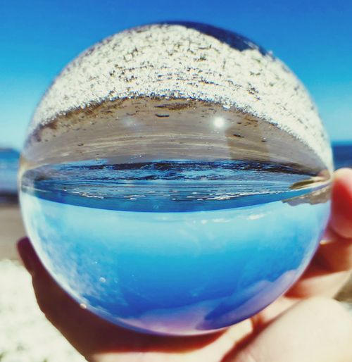 The whole world in my hand. Scenics Malephotographerofthemonth EyeEm Gallery EyeEm Nature Lover EyeEm Best Shots IPhoneography Glassball Blue Close-up Human Hand Holding Drink Refreshment Human Body Part Glass - Material Glass Still Life Nature Freshness