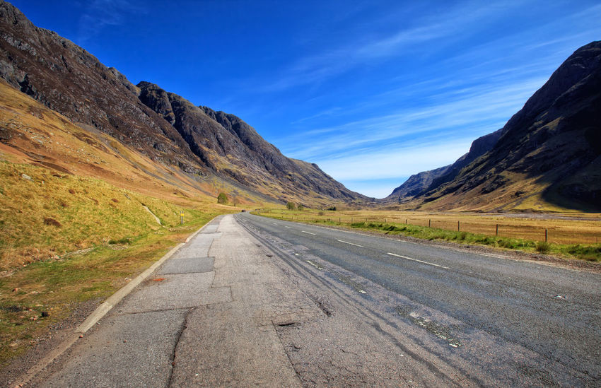 Endless road between mountains in Glencoe Area, Scottish Highlands, Scotland, UK Day EyeEm Gallery Glencoe Glencoe Scotland Landscape Landscape_Collection Landscapes Mountain Mountain Range Mountains Nature Nature Reserve No People Outdoors Range Road Rural Area Rural Road Scenic Scenic View Scenics Scotland Scotland 💕 Scottish Highlands Sky