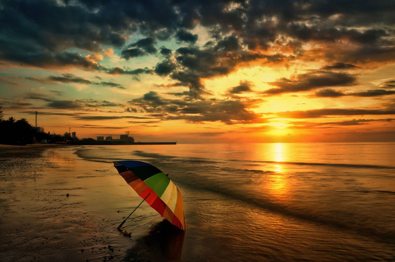 Sunrise at Kemala beach Sunset Sky Cloud - Sky Water Sea Beauty In Nature Scenics - Nature Orange Color Horizon Nature Tranquility Tranquil Scene Beach Flag Land Horizon Over Water No People Idyllic Outdoors Umbrella