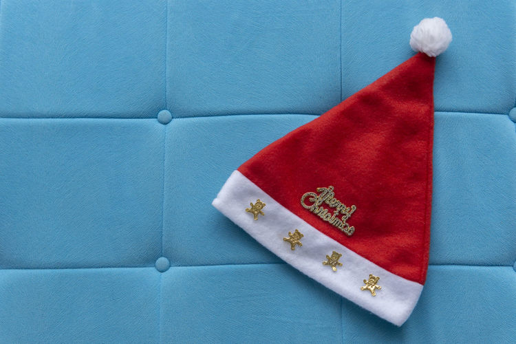 Christmas Hat HEAD Cap Isolated Seasonal Holiday Furry Celebration Christmas Hat Xmas Blue Celebration Close-up Colored Background Copy Space Creativity Decoration Directly Above Holiday Indoors  No People Paper Red Single Object Still Life Studio Shot White Color The Minimalist - 2019 EyeEm Awards