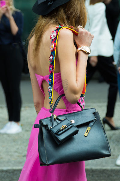 Chiara Ferragni with Birkin bag. Street style at Milan Fashion Week Women's wear Spring/Summer 2016 outside Giorgio Armani show, September 28th, 2015. Chiara Ferragni Fashion Milano Milano Fashion Week Street Style From Around The World Bag Birkin Carrying Day Focus On Foreground Italy Luggage Milan Fashion Week One Person Outdoors Pink Color Purse Real People Rear View Street Style Suitcase Well-dressed Women