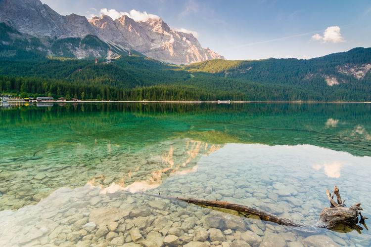 Summer morning at lake Eibsee Bavaria Eibsee Karwendel Travel Vacations Wettersteingebirge Alps Bavarian Alps Destination Europe Forest Garmisch-partenkirchen Germany Grainau Idyllic Karwendelgebirge Lake Landscape Mountain Nature Outdoors Reflections Summer Tranquility Woods