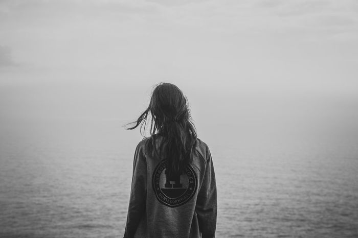 Contemplation Beauty In Nature Casual Clothing Day Hair Hairstyle Horizon Over Water Leisure Activity Lifestyles Long Hair Looking At View Nature One Person Outdoors Real People Rear View Sea Sky Standing Waist Up Water Women