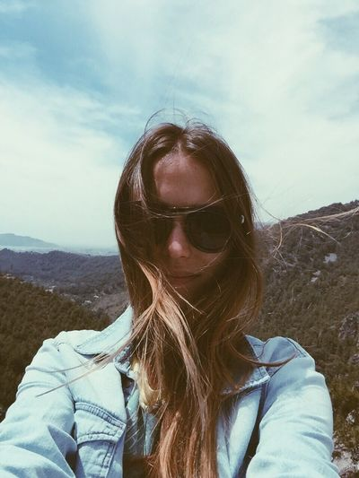 Portrait of woman with sunglasses against sky