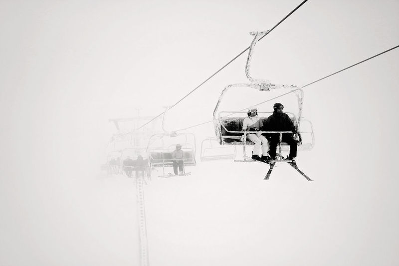 Ski Lift in fog EyeEm Selects EyeEm Best Shots Skiing Ski Lift Foggy Weather Snowcapped Mountain Snowing Minimalism Togetherness Men Sportsman Full Length Sky My Best Photo