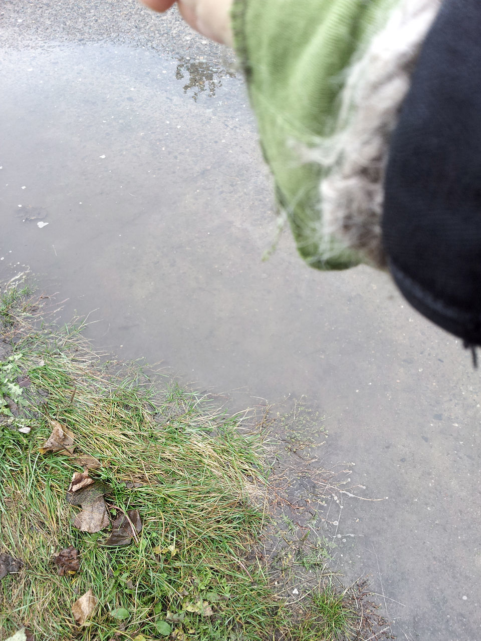 CLOSE-UP LOW SECTION OF PERSON IN WATER
