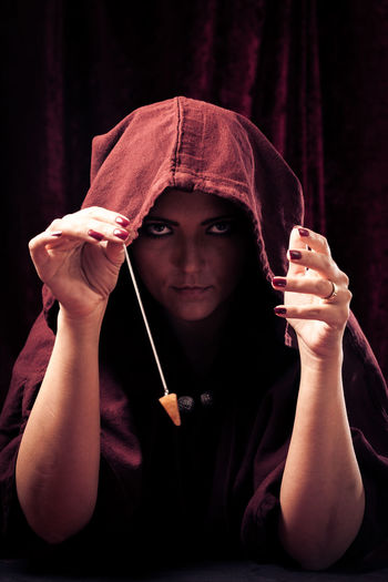 Psychic reading your future Witchcraft  Beautiful Woman Brunette Charlatan Clairvoyance Close-up Forecast Future Indoors  Magic Magick Medium One Person Pendulum People Portrait Psychic Psychic Medium Spooky Studio Shot Witch Women Young Adult