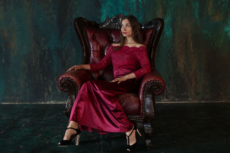 Portrait of young woman sitting on chair