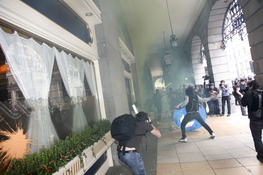 Taken outside of The Ritz Hotel during an anti-austerity march in London. Anti Austerity Destruction Paint Protest Smoke Action Building Exterior City Damaged Freedom Of Assembly Freedom Of Expression Freedom Of Speech Men Paint Bomb People Protesters Real People Riot Road Sign Smoke Bomb The Ritz  The Ritz Hotel London
