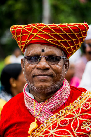 Close-Up Portrait Of Mature Man Wearing Traditional Costume