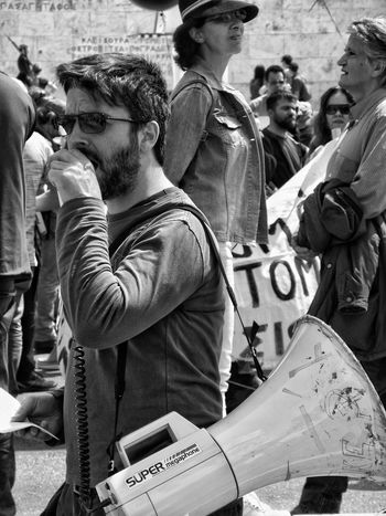 April 2016 Strike! Protesters On The Streets Syntagma Square Greek Parliament Protesting Against Poverty Athens Athens, Greece Coordinator Real People Streetphotography Street Photography Blackandwhite Black And White Black & White Blackandwhite Photography Black&white