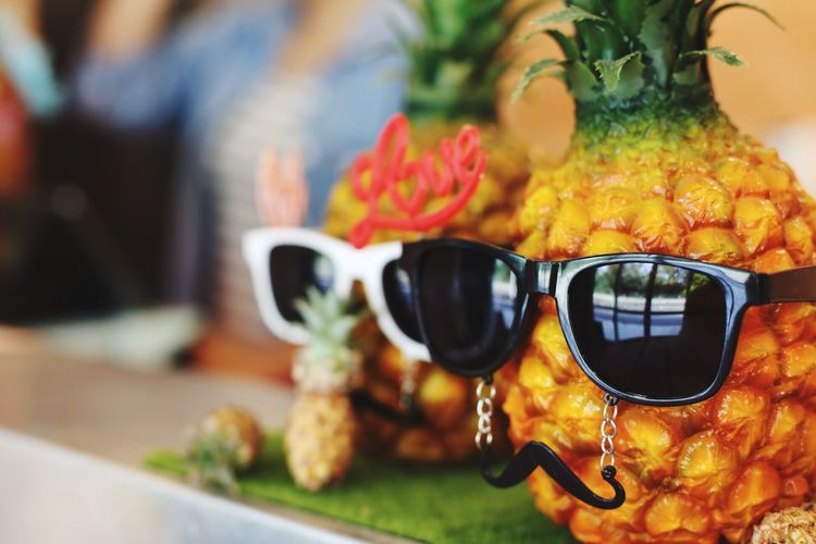 Close-Up Of Pineapples With Sunglasses On Table