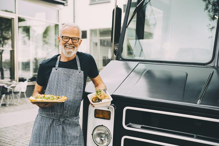 Full length portrait of man having food