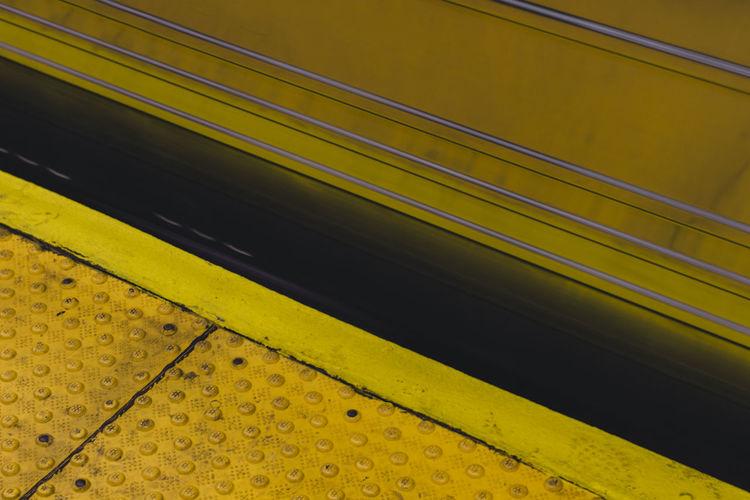 Lines NYC Close-up Commute Day Indoors  Mode Of Transport Mta No People Public Transportation Rail Transportation Railroad Station Railroad Station Platform Subway Train - Vehicle Transportation Yellow