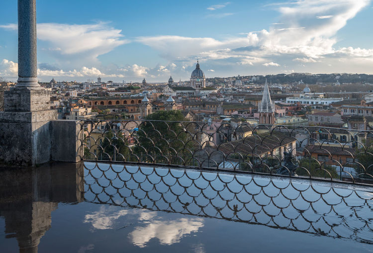 Cityscape of the old city of Rome in Italy from the Belvedere Terrace in the Pincio Gardens Ancient Church City Cityscape Old Town Reflection Rome Skyline Sunlight Travel Belvedere Dome Gardens Italy Pincio Rome Italy Travel Destinations Water