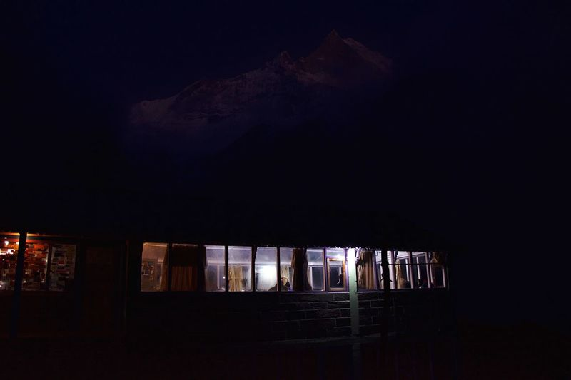 In the Mountain shade. Himalayas Mountains Mountain Night Architecture Built Structure Building Exterior Illuminated Dark Window Building Outdoors Nature Lifestyles Sky House