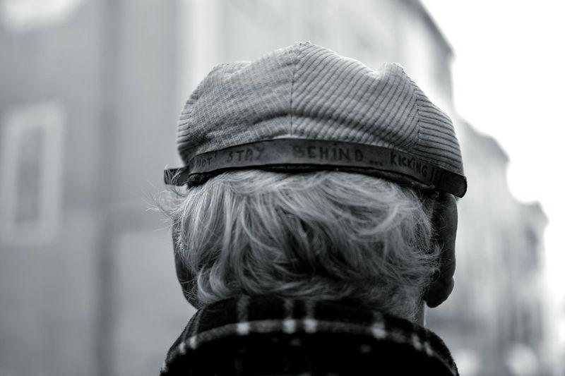 Rear View Of Senior Man Wearing Cap