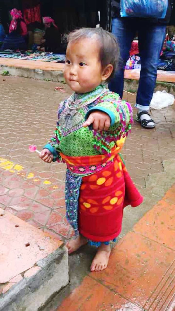 child, childhood, full length, innocence, baby, real people, one person, cute, young, incidental people, babyhood, footpath, casual clothing, toddler, day, clothing, looking away, standing, outdoors