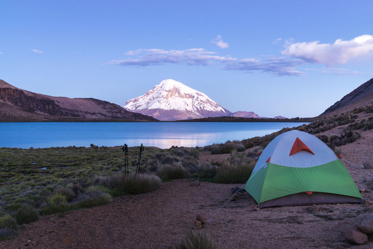 Sajama National Park Beauty In Nature Camping Cloud - Sky Day Environment Lake Land Landscape Mountain Mountain Peak Nature No People Non-urban Scene Outdoors Scenics - Nature Sky Snowcapped Mountain Tent Tranquil Scene Tranquility Water Winter
