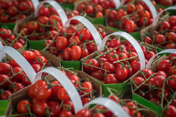 Farmers Market Abundance Backgrounds Cherry Tomatoes Close-up Food Food And Drink For Sale Freshness Fruit Full Frame Healthy Eating Large Group Of Objects Market Market Stall No People Red Retail  Retail Display Ripe Sale Still Life Tomato Vegetable Wellbeing