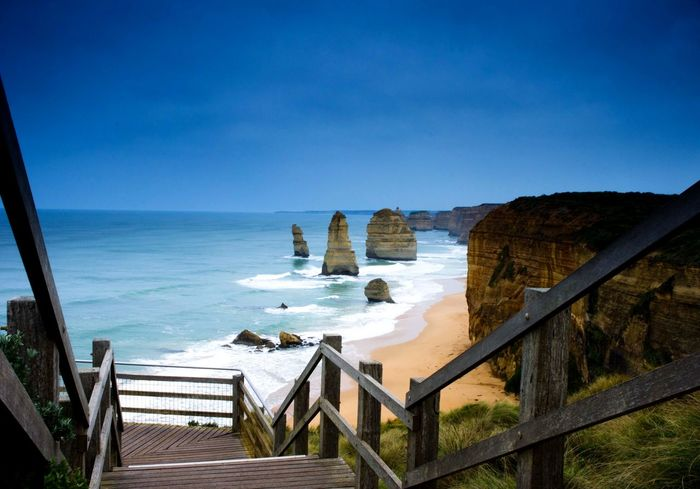 You are the first Limestone Beach Stairs Viewing Platform Road Trip Twelve Twelve Apostles Greatoceanroad Sea Railing Scenics Water Nature Blue Beauty In Nature Tranquil Scene No People Clear Sky Sky Outdoors Day The Traveler - 2018 EyeEm Awards