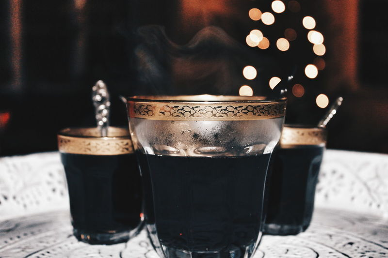 Close-Up Of Black Coffee On Table During Christmas