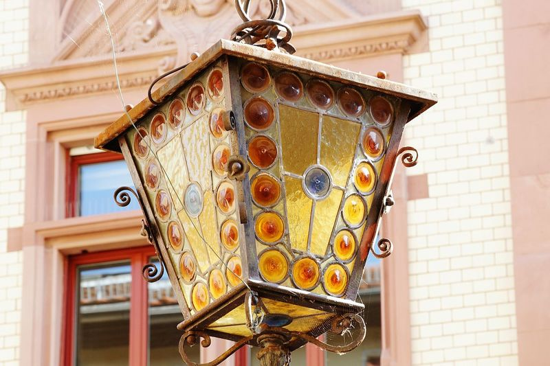 Low angle view of glass lantern