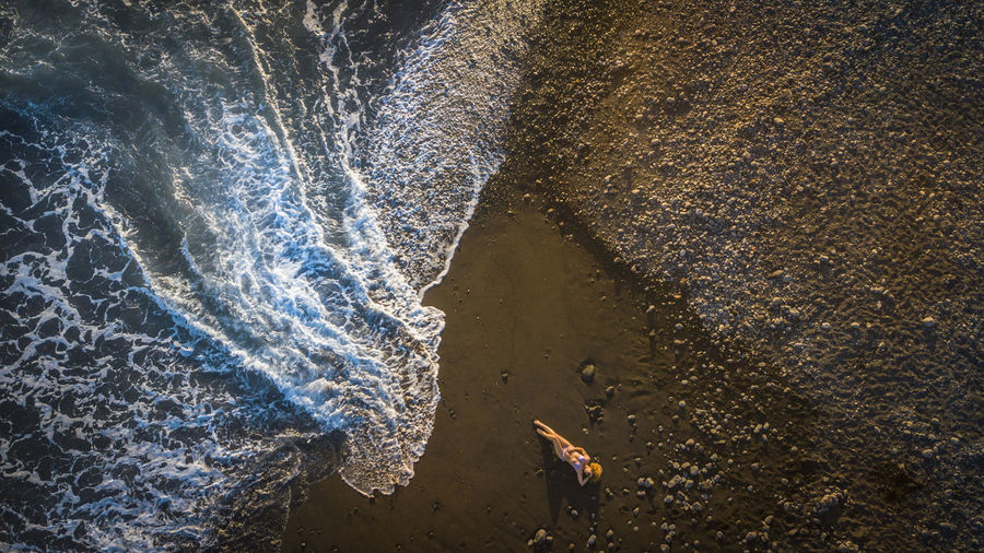 Aerial View Of Mature Woman Lying At Beach